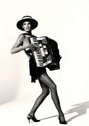 Linda Evangelista playing