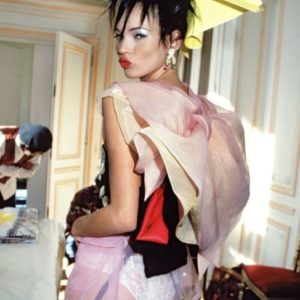 Kate Moss behind the scenes at the John Galliano Fall 1994 show. Photographed by Roxanne Lowit.