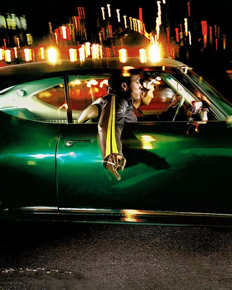 Two guys in green car